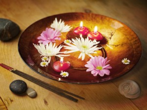 bowl with floating flowers and candles