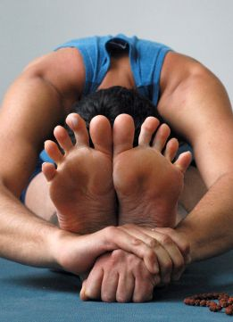 close-up of man's feet in yoga position