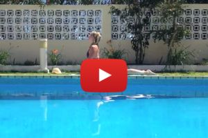 Youtube video still of woman practising yoga next to a pool