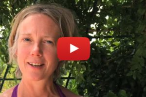 Video still from woman talking about a yoga retreat